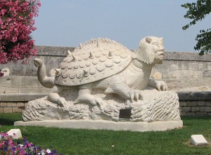 via Wikimedia Commons, Public Domain image of a Tarasque statue, Tarascon, France